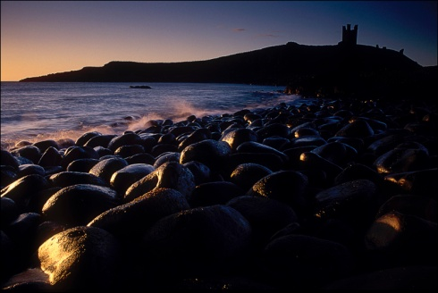 Dunstanburgh, at dawn.